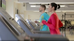 Training on the treadmills in the gym center - stock footage