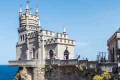 Yalta, Crimea - June 5, 2014: Tourists walking near the Castle Swallow's Nest - stock photo