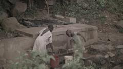 Africa poor African girls fill and carry water bucket 3 Stock Footage