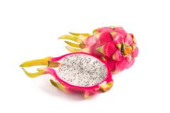 Cut section of dragon fruit and a whole one Stock Photos