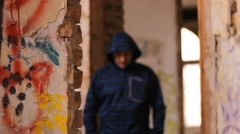 Hip Hop ghetto house with a graffiti and bum - stock footage