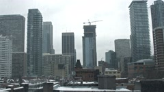 Snow blast in a winterstorm in downtown toronto Stock Footage