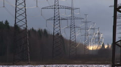 High voltage electric lines at sunset, HD footage Stock Footage