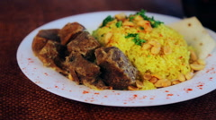 Food, boiled rice with meat and peanuts. Stock Footage