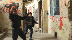 Posing Ghetto kids play young kids dances in the ghetto neighborhood having fun - stock footage