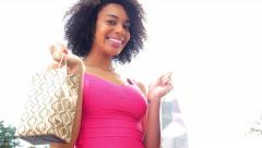 Excited happy african american woman with shopping bags outdoors Stock Footage