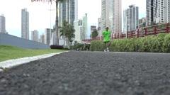 Man jogging, Panama City, Panama Stock Footage