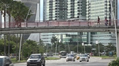 Pedestrian bridge above highway, La CintaCostera, Panama City, Panama Stock Footage