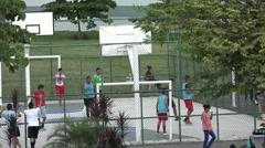 Young adults playing football. La Cinta Costera, Panama City, Panama Stock Footage