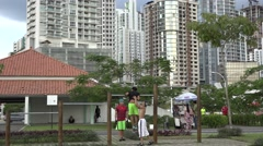 Young men excersise on La Cinta Costera, Panama City, Panama Stock Footage