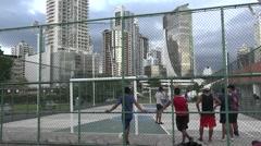 Young men playing soccer, La Cinta Costera, Panama City, Panama Stock Footage