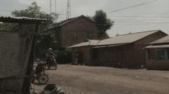 Africa radio antenna street motorbike tilt up 2 Stock Footage