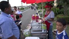 Street food stand on La Cinta Costera, Panama City, Panama Stock Footage