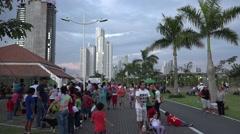 Panamanians adults and children on La Cinta Costera, Panama City, Panama Stock Footage