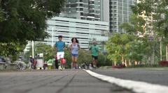 Joggers, La Cinta Costera, Panama City, Panama Stock Footage
