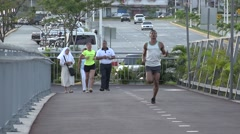 Pedestrians and joggers on La Cinta Costera, Panama City, Panama Stock Footage