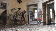 Ghost ghetto house with a graffiti and bum - stock footage