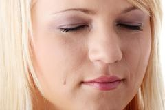 Emotional portrait with tears on the face Stock Photos