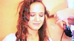 Woman doing her hair twisting around Hair curling. HD. 1920x1080 Stock Footage