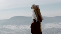 Female Druid casting on mountain - stock footage