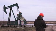 Gas pump worker pump oil jack working - stock footage
