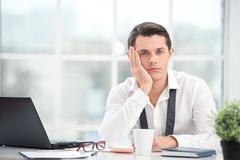 Businessman is bored while working with computer - stock photo
