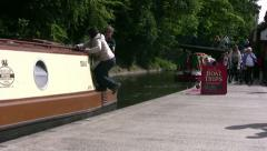 Woman boards a moving narrowboat at Llangollen Stock Footage
