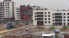 Asphalt pavement works between new build modern flat houses Stock Footage