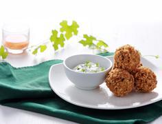 Greek cuisine fried crispy zucchini and feta balls - stock photo