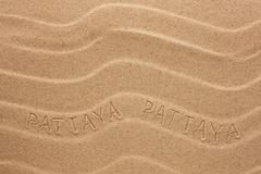 Pattaya  inscription on the wavy sand Stock Photos
