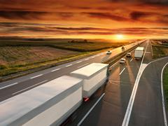 Truck in motion blur on the highway - stock photo
