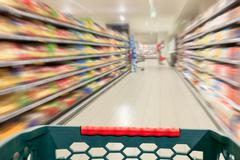 Shopping concept at supermarket in motion blur Stock Photos