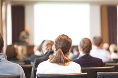Audience in the lecture hall. - stock photo