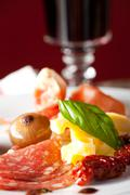 Mixed italian antipasti on a plate with wine Stock Photos