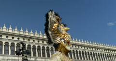 Venetian mask with feathers in San Marco square Stock Footage