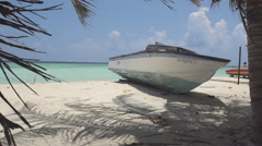 Establishment Shot Of Antique Wooden Boat On Pristine Beach - stock footage