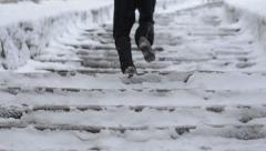 Running up the stairs Stock Footage