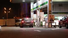Motor cars on refuelling station Stock Footage