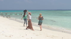 Establishment Shot Of Female Tourist At Pristine Beach - stock footage