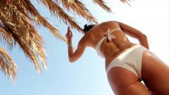 Bottom of girl on the beach dancing sky Stock Footage