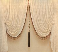 Vintage drapes with gold embellishments - stock photo