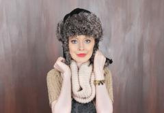 Young beautiful blue eyed girl wearing traditional warm Russian cap Stock Photos