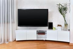 Large flat screen TV in modern interior living room - stock photo