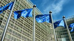 European Union flags waving in the wind in front of European Commission. Stock Footage