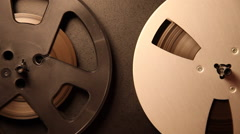 Magnetic tape reels in play mode, spinning, old reel to reel, studio Stock Footage