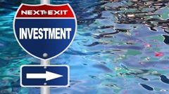 Investment road sign with blue water wave background Stock Footage