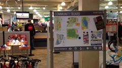One side of sportchek with community board in front of store Stock Footage