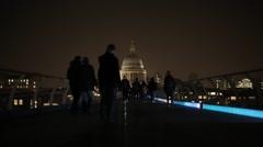 People walk on Millenium Bridge (London) at night | HD 1080 Stock Footage