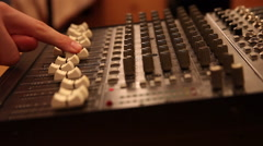 Hand on a sound mixing console, producer, film, music, studio,equipment Stock Footage