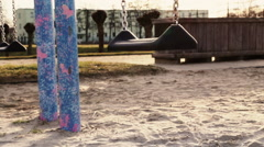 Lonely, uncrowded Swing on Playground Stock Footage
